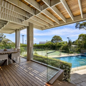 decking, swimming pool and tennis court