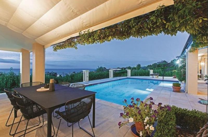pool and decking overlooking ocean